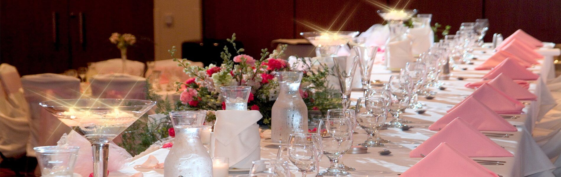 Elegant wedding table settings white with pink accents